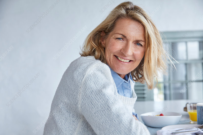 Portrait smiling senior woman at breakfast