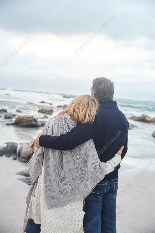 Couple hugging on winter beach