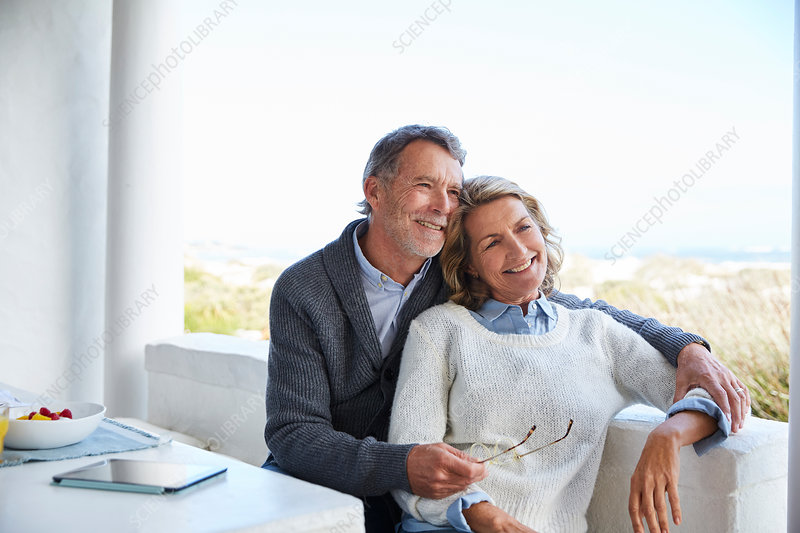 Smiling senior couple relaxing on patio