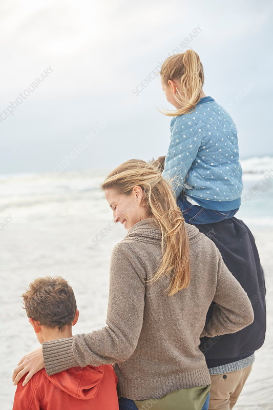 Family walking on winter beach