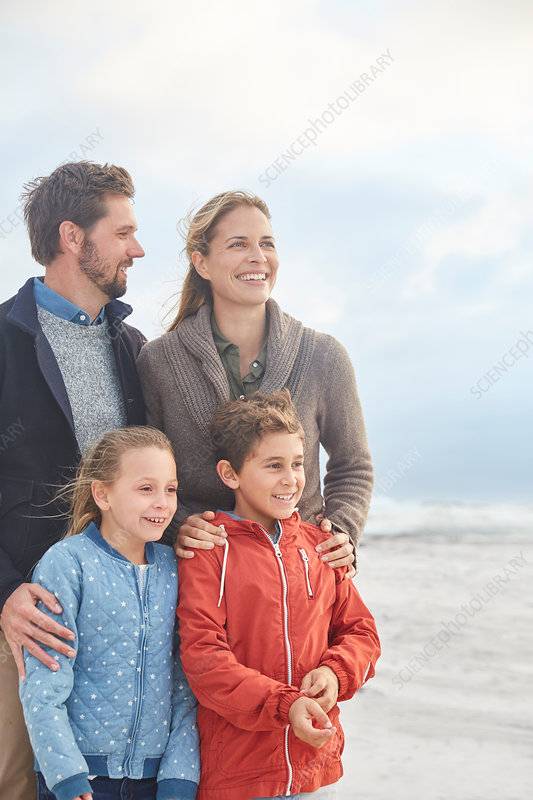 Smiling family on winter beach