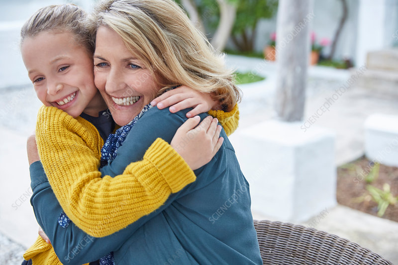 Enthusiastic grandmother and granddaughter hugging
