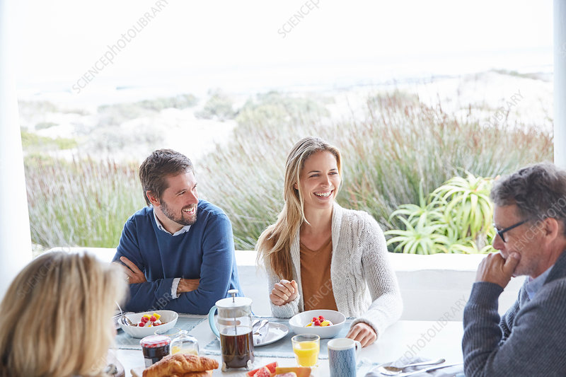 Couples enjoying breakfast on beach patio
