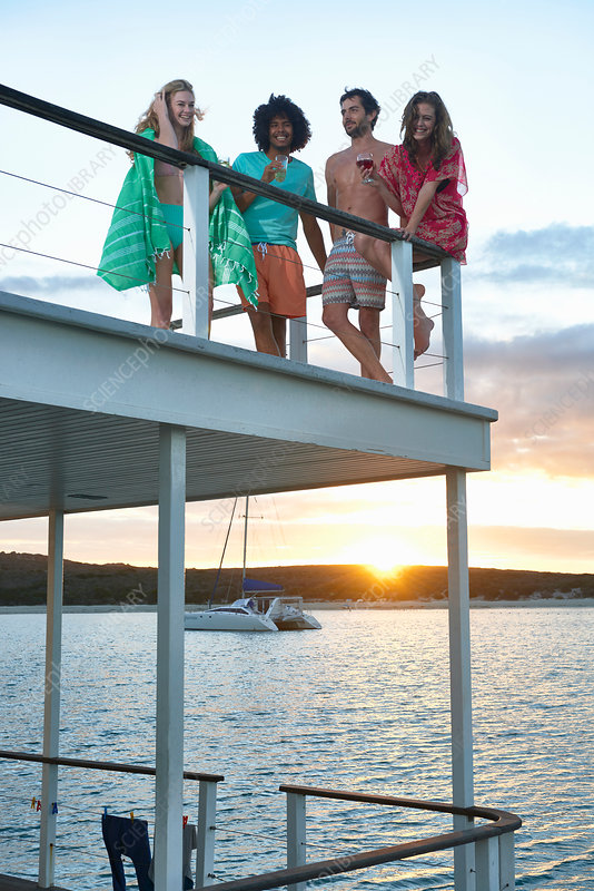 Young friends hanging out on summer houseboat