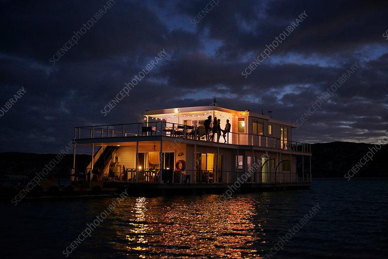 Summer houseboat illuminated