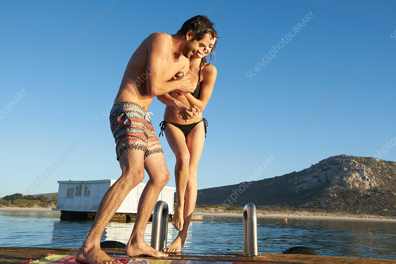 Young couple playing dock