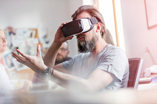 Male designer using virtual reality glasses