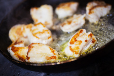 Close up of scallops in a frying pan
