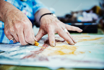 An artist working hands drawing on canvas