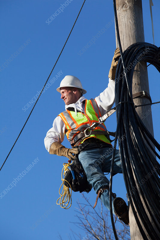 Cable lineman reviewing cable path