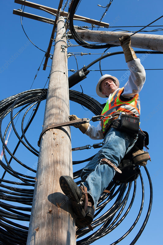 Cable lineman checking support wire tension