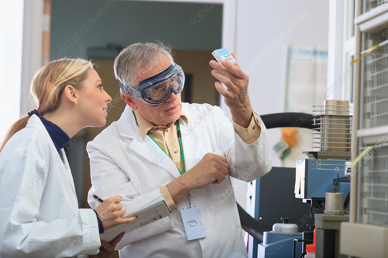 Professor working with engineering student