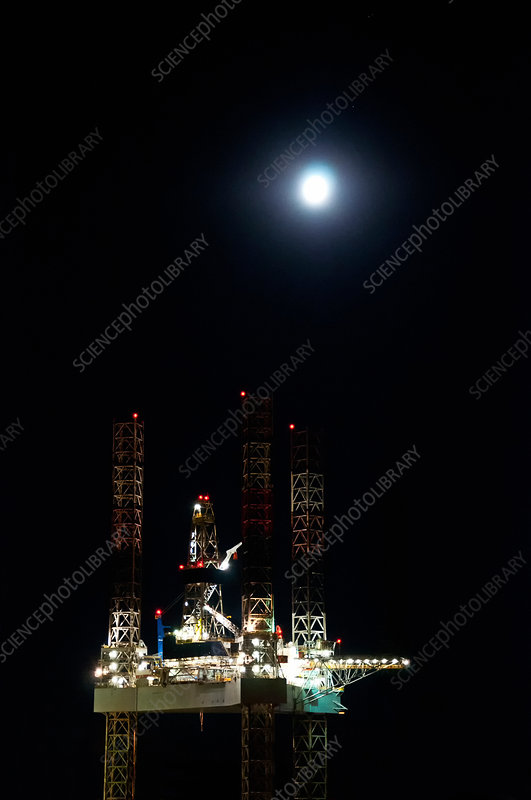 Offshore oil rig at night
