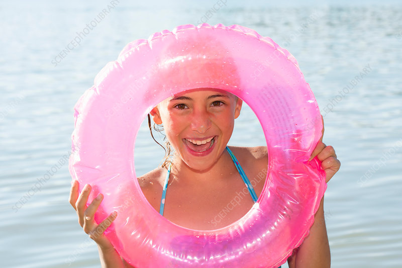 Girl holding pink inflatable ring
