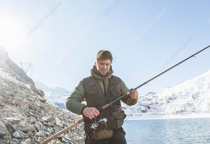 Mid adult man, fishing, Italy