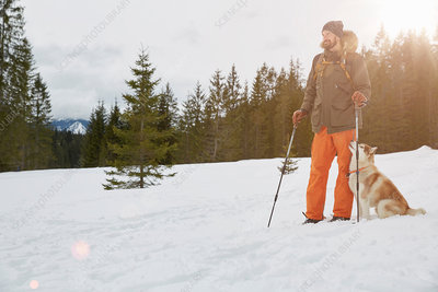Mid adult man on snow shoes