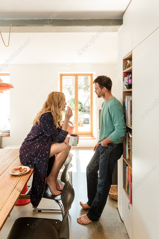 Couple in dining room talking