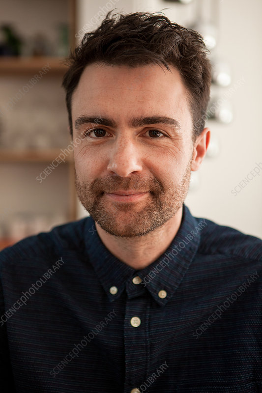 Man with stubble smiling
