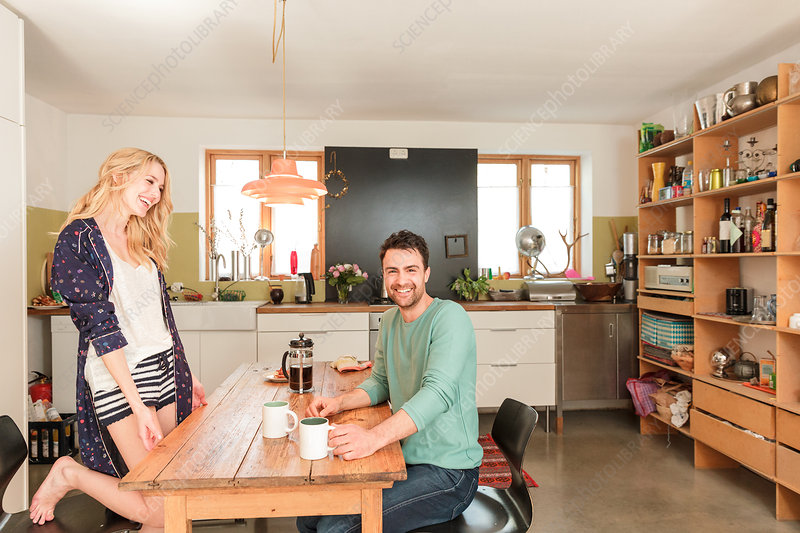 Couple at dining table having coffee