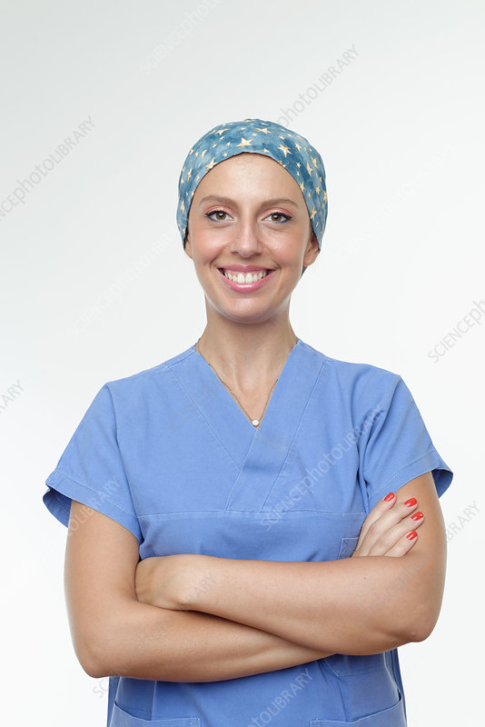 Surgeon with arms crossed smiling