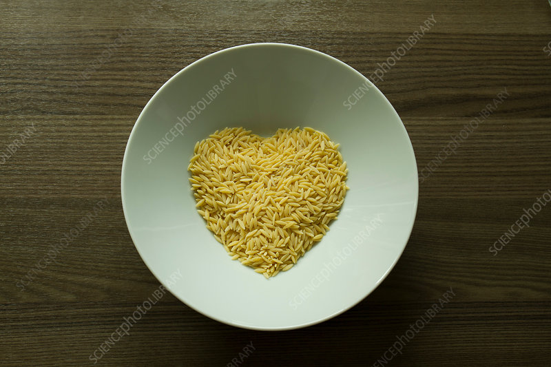 Pasta in shape of heart in bowl
