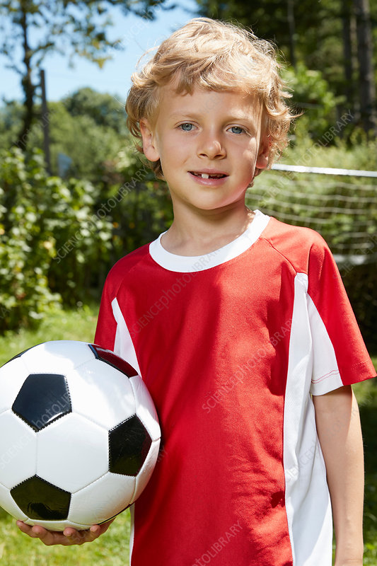 Portrait of boy wearing soccer uniform