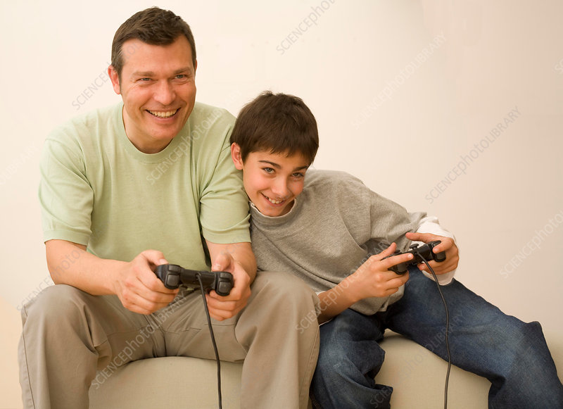Boy and father playing video game