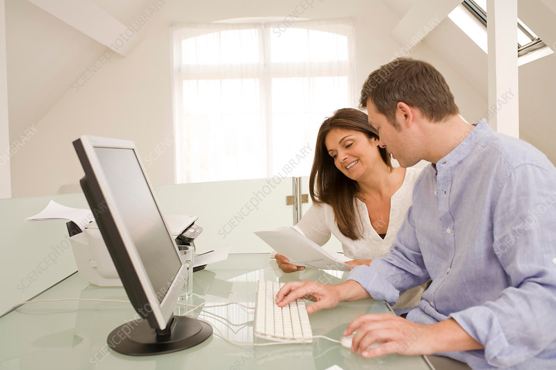 Mature couple checking bills and paperwork