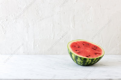 Half a watermelon on marble table