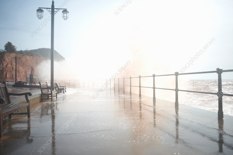 Stormy waves splashing over promenade