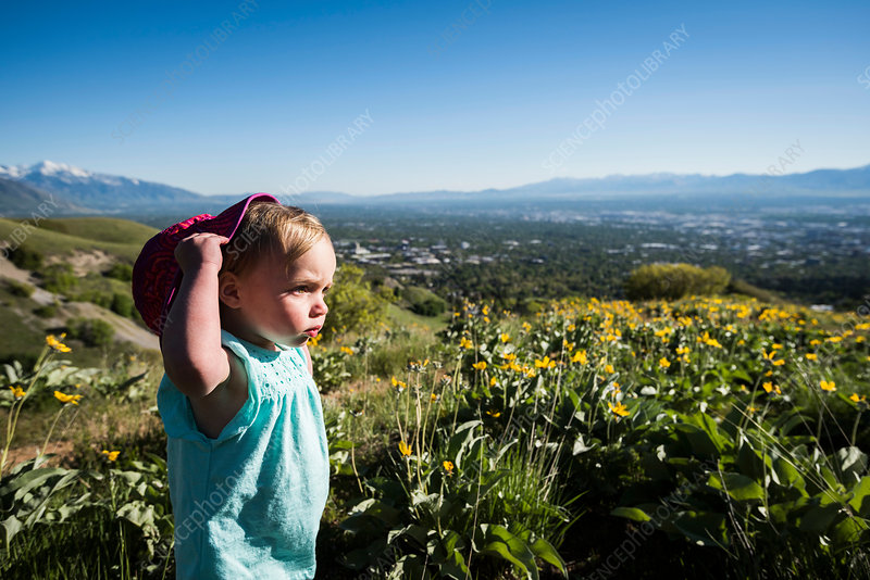 Young girl in field, Utah, USA