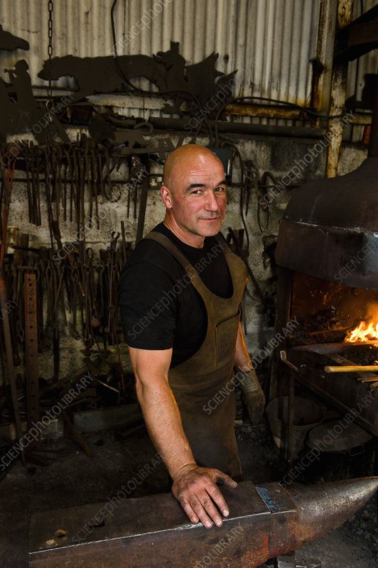 Portrait of blacksmith at work