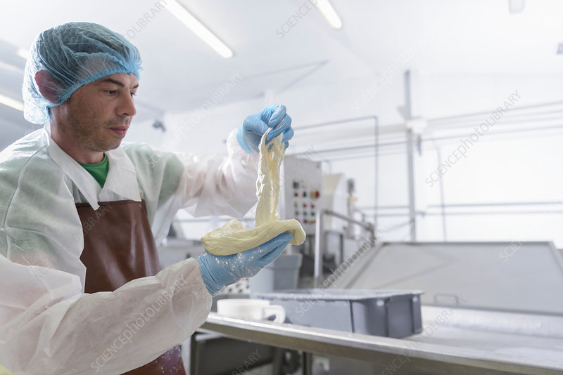 Worker hand making Burrata cheese