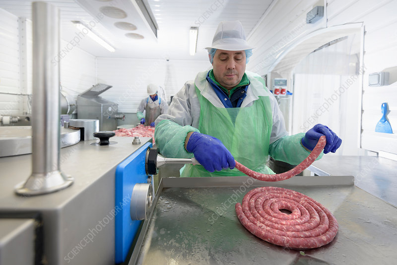 Worker making Italian sausages