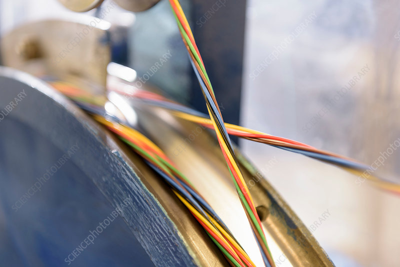 Multicoloured cable in cable factory, close up