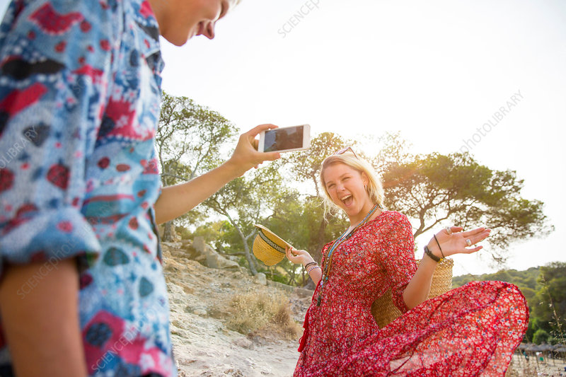 Couple using smartphone to take photographs