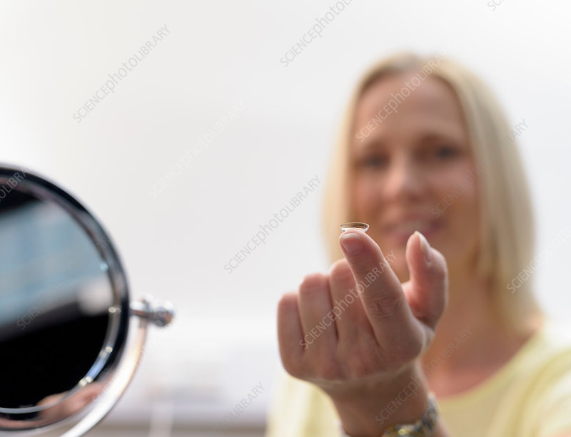 Patient trying on contact lens, close up