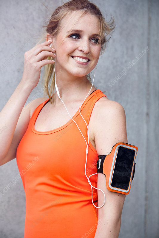 Woman with wearable technology and headphones