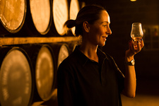 Female taster at whisky distillery