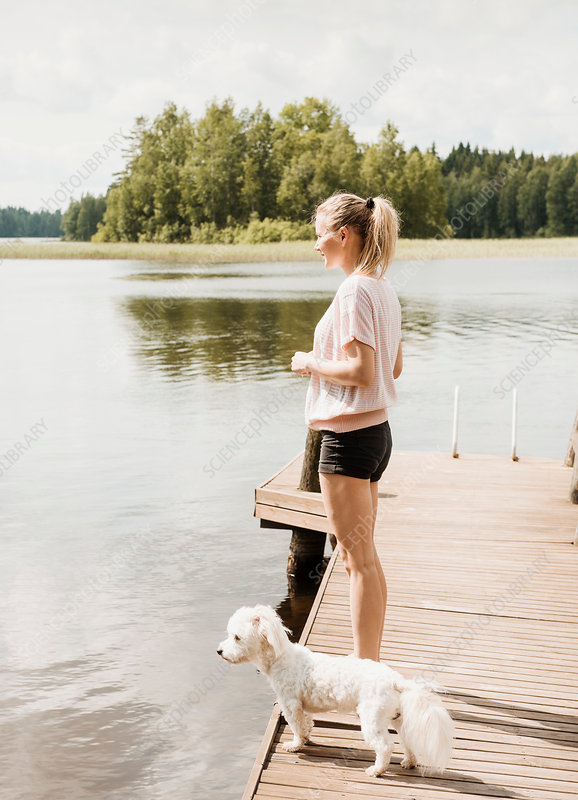 Woman standing with Dog, Finland