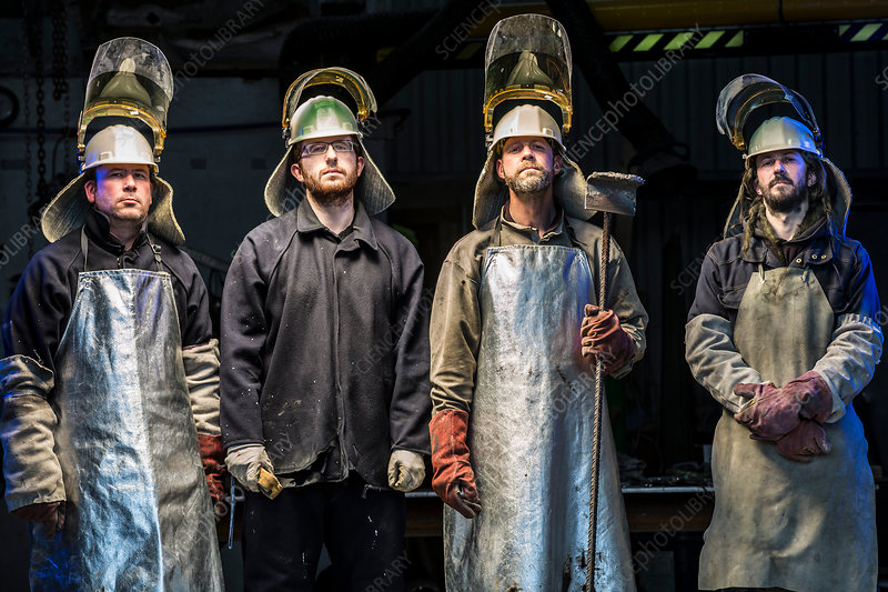 Foundry workers wearing protective clothing