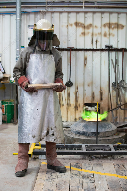 Male foundry worker in bronze foundry