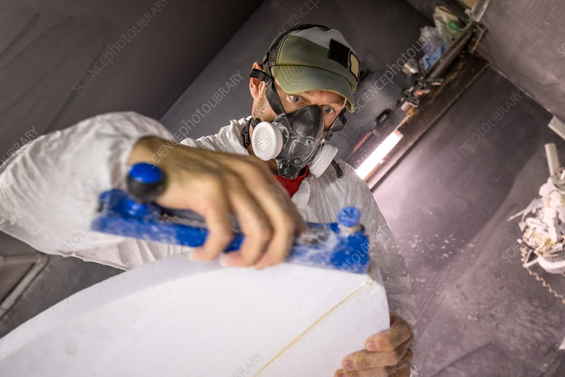 Male carpenter at work on surfboard