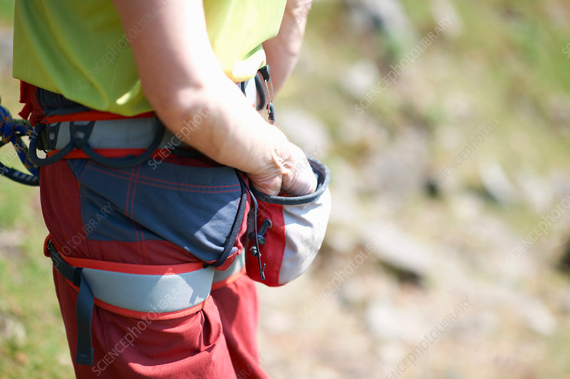 Mountain climber with hand in pocket