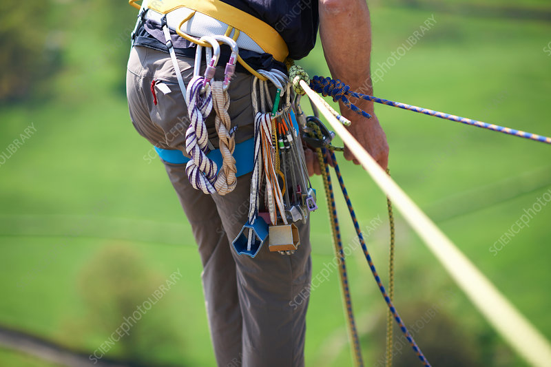 Rock climber preparing climbing ropes