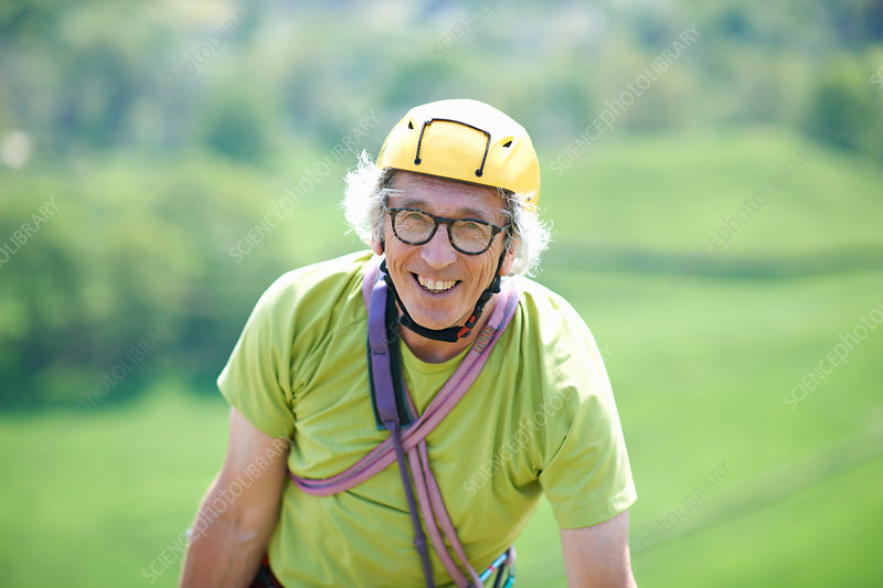 Portrait of senior man wearing climbing helmet