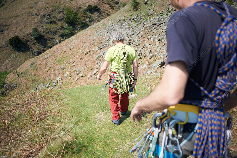 Rock climbers walking on hillside