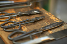 Close up of glassblowers hand tools