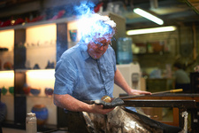 Glassblower in workshop