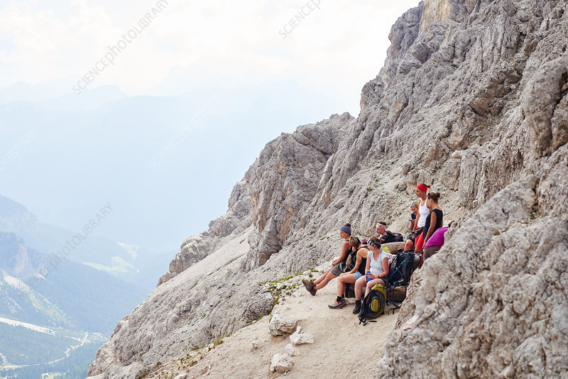 Group of hikers resting on mountainside